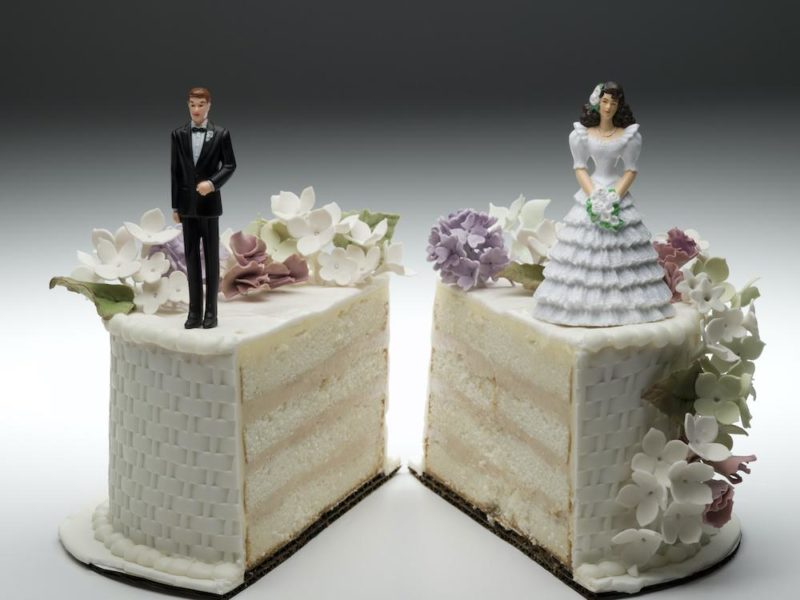 a wedding cake cut in half. married couple divorced